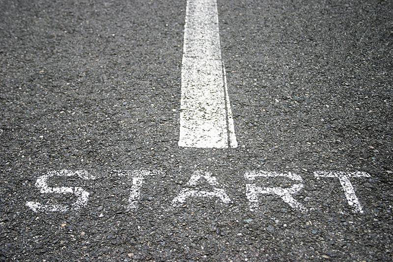 white starting line on a blacktop surface